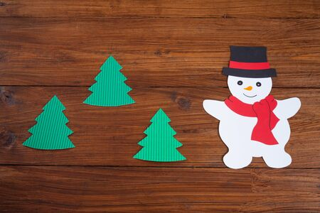 snowman wood: Snowman and fir trees on wood