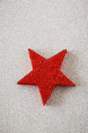 still lifes: Red star on silver background Stock Photo
