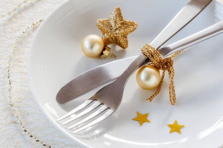 christmastime: Christmas time, decorated plate, cutlery Stock Photo