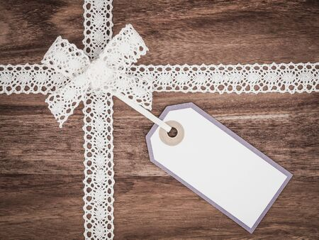 white lace: Christmas, lace, gift tag, present Stock Photo