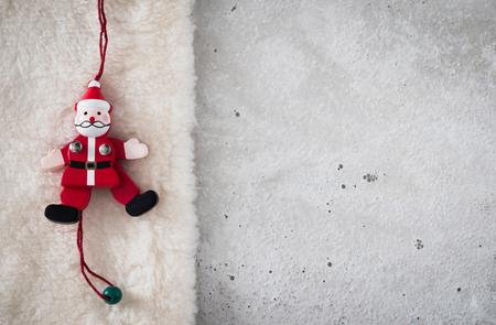 wood figurine: Christmas decoration, Santa Claus on plush, concrete, copy space