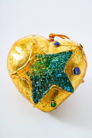 patina: Golden Christmas bauble with patina effect Stock Photo