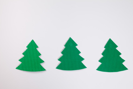 tinkering: Fir trees, white background, copy space Stock Photo
