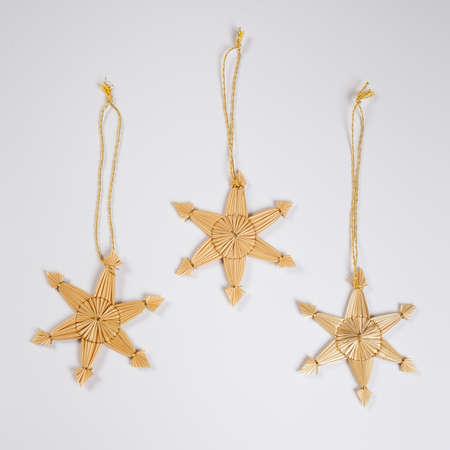 still lifes: Straw stars, white background Stock Photo