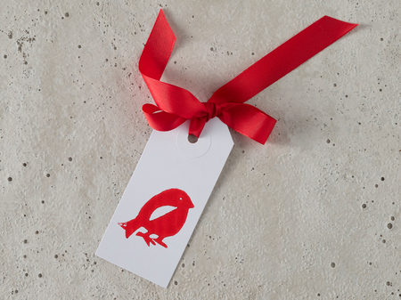christmas gift tag: Christmas, gift tag, red ribbon, background concrete Stock Photo