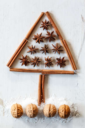 tinkering: Christmas tree of cinnamon sticks, star anise and walnuts on white wood