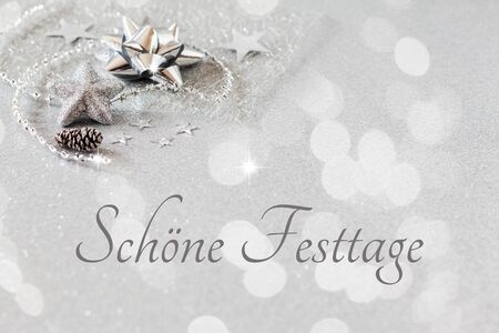 happy holidays: Christmas arrangement with decorations, silver, German wishes, Happy holidays