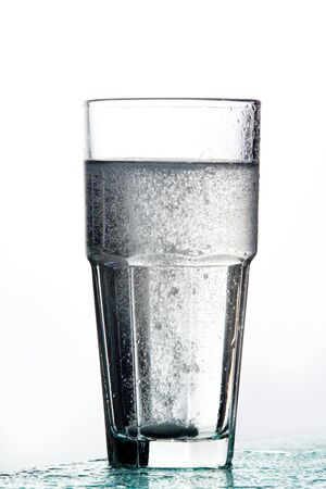 fizzy tablet: Glass of water with fizzy tablet Stock Photo