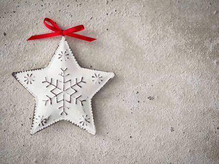 hormig�n: Christmas decoration, star of metal on concrete Foto de archivo
