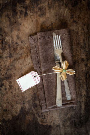 christmastime: Christmas time, decorated cutlery, brown napkin, copy space