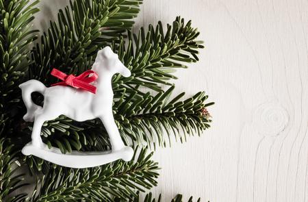 evergreens: Christmas decoration, evergreens, white wood, rocking horse