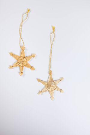 still lifes: Straw stars, white background, copy space