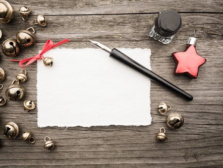 decoration: Christmas decoration, card, inkwell, quill and bells