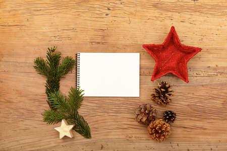 fir twig: Notepad, fir twig and cones on wood