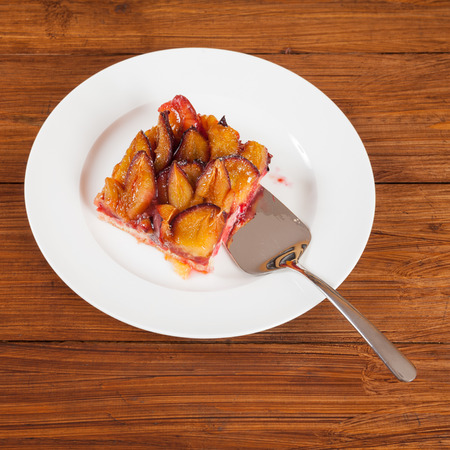 afters: Plum cake, piece of cake, cake shovel on plate