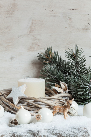 decorations wreaths: Christmas decoration with candle, wreath, fawn figurine and baubles