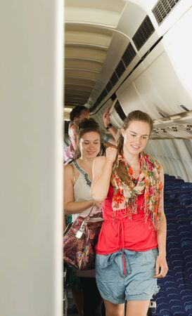 getting out: Germany,Munich,Bavaria,Passengers getting out from economy class airliner