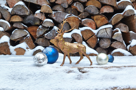 woodpile: Deer figurine and baubles in snow, woodpile