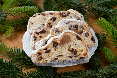 evergreens: Christstollen on plate, evergreens Stock Photo