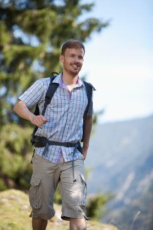 mid adult: Germany,Upper Bavaria,Mid adult man hiking,smiling