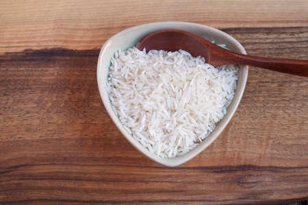 basmati rice: Basmati rice in bowl, wooden spoon