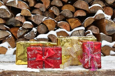 woodpile: Christmas presents in front of woodpile