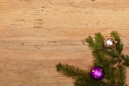 fir twig: Fir twig and baubles on wood, copy space Stock Photo