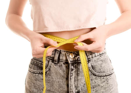 woman measuring: Young woman measuring abdominal girth