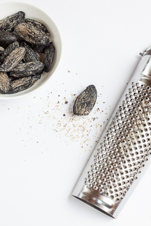 grater: Tonka beans and grater Stock Photo
