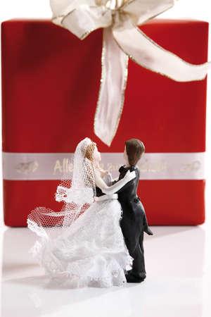 figurines: Wedding couple figurines embracing Stock Photo