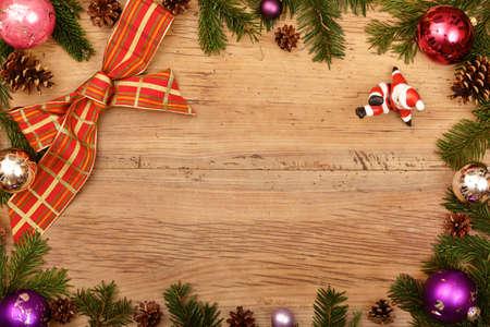 wood figurine: Fir twigs, ribbon and Santa Claus figurine on wood