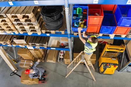warehouseman: Germany,Bavaria,Munich,Manual workers working in warehouse