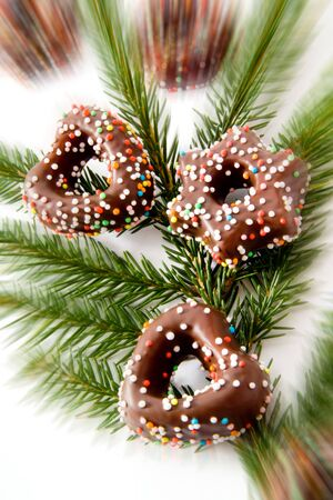 chocolate icing: Christmas cookies with chocolate icing, fir branch Stock Photo