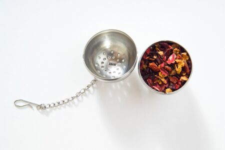 infuser: Tea strainer, fruit tea, white background Stock Photo