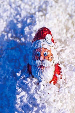 twee: Chocolate santa claus in artificial snow Stock Photo