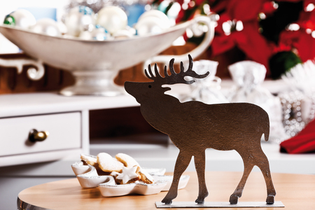 christmas elk: Christmas decoration, elk figurine and christmas cookies on table