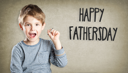 exhilaration: Boy on grunge background, writing, Happy Fathersday Stock Photo