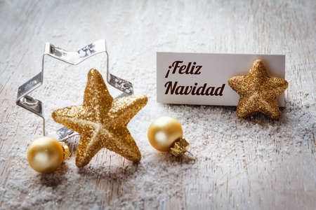 still lifes: Christmas time, Still life with spanish wishes, sign, on wood Stock Photo