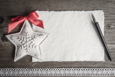 christmas border: Christmas card, christmas decoration, star, quill and lace Stock Photo