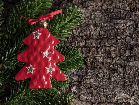 evergreens: Christmas decoration on bark, evergreens, christmas tree of metal Stock Photo
