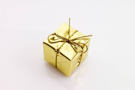 gift spending: Small christmas present in gold foil Stock Photo