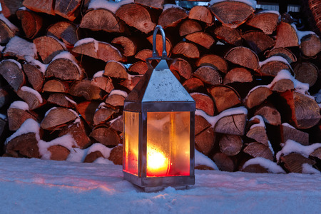 woodpile: Storm lamp in winter, woodpile
