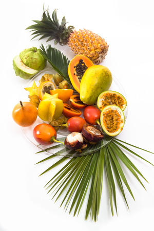 Different tropical fruits, white background