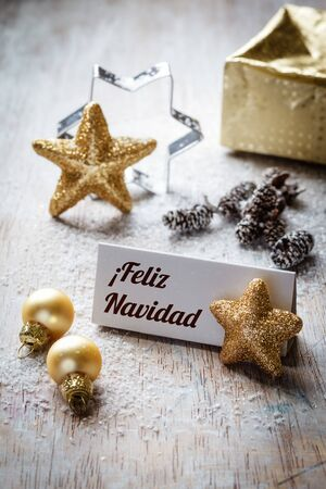happy holidays: Christmas time, Still life with spanish wishes, sign, on wood Stock Photo