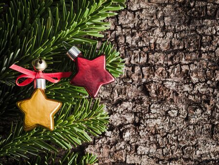 christmastime: Christmas decoration on bark, evergreens, stars
