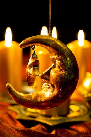 half moon: Christmas decoration, candles and golden half moon Stock Photo