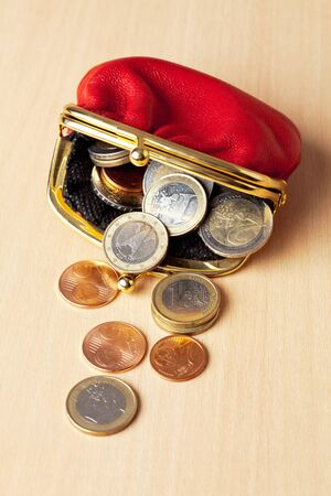 change purses: Red purse filled with euro coins Stock Photo