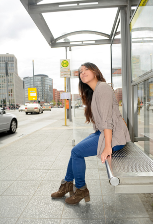Germany, young female tourist waiting for bus at Potsdamer Square in Berlin Zdjęcie Seryjne - 48233546