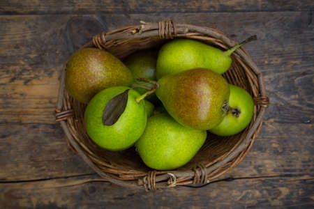 sort: Old pear sort Gute Luise in basket Stock Photo
