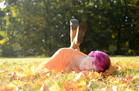 autumnally: Young woman in park in autumn